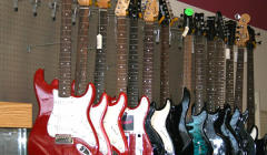 Guitars and other musical instruments at Top Cash Pawn and Loan